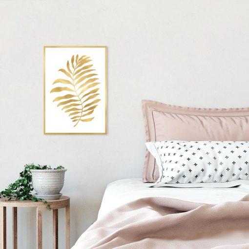 plakat z motywem złotego liścia