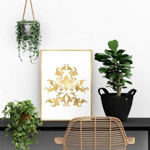 plakat z lustrzanymi złotymi liśćmi