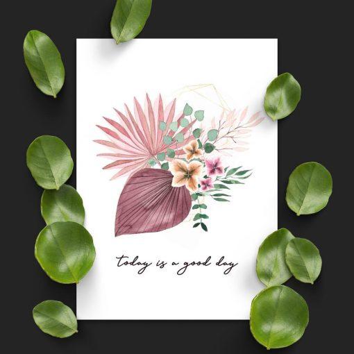 Plakat z różowymi kwiatami i napisem