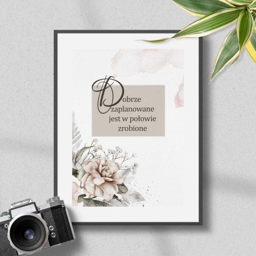 Plakat z motywem kwiatowym i sentencją