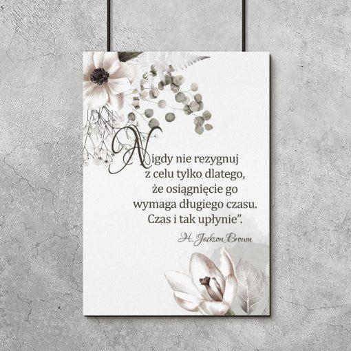 Plakat z motywem florystycznym oraz maksymą życiową