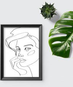 Plakat ze szkicem damskiej twarzy