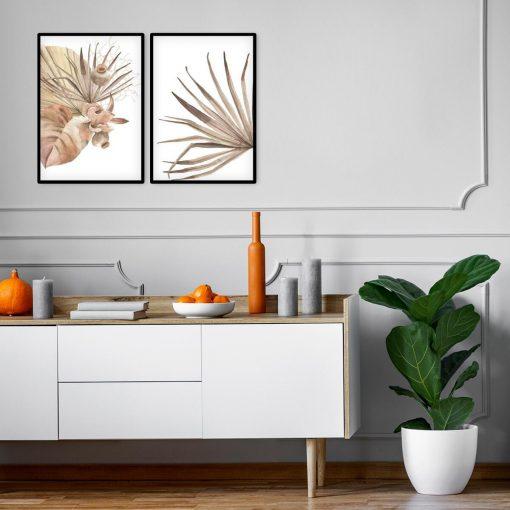 Dwa plakaty z tropikalnymi liśćmi